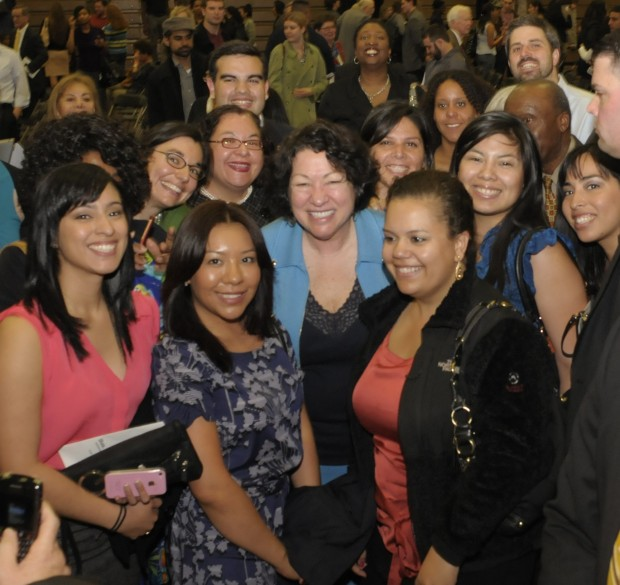 Justice Sotomayor posing with students
